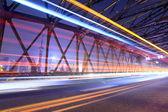 Light trails through the garden bridge in shanghai — Stock Photo