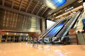 Modern escalators in hall — Stock Photo