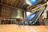 Modern escalators in hall — Stock Photo