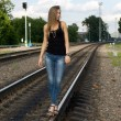 Girl traveling by railroad — Stock Photo