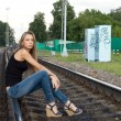Girl sitting on rails - Stock Photo