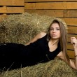 Girl lying on hay — Stock Photo