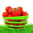 Bowl with fresh strawberries on grass — Stock Photo #10954965