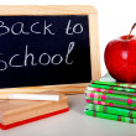 Back to school: blackboard slate and stack of books — Stock Photo #11121361