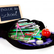 Back to school: blackboard slate on bag with books — Stock Photo