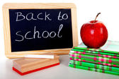 Back to school: blackboard slate and stack of books — Stock Photo