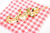 Little prawn snacks on napkin — Stock Photo