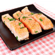 Stock Photo: Plate with fresh salmon on checkered napkin