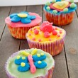 Tray with colorful decorated cupcakes - ストック写真