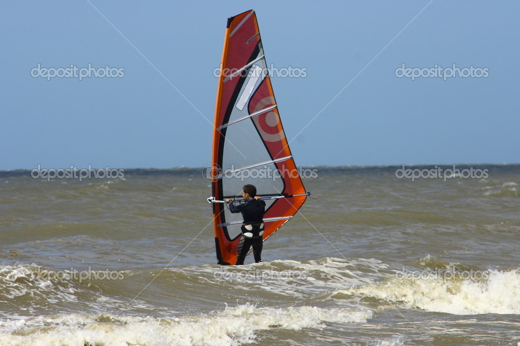A wind surfer traverses the surf   — Stock Photo #11380637