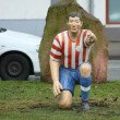 Life-size football figure - Stock Photo