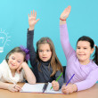 Three happy girls doing their school work — Stock fotografie #10798385
