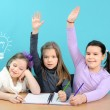Three happy girls doing their school work — Stock Photo