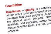 Gravitation text highlighted in red — Stock Photo