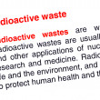 Radioactive waste text highlighted in red — Stock Photo