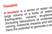 Tsunami text highlighted in red — Stock Photo