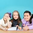 Happy school girls doing their work in classroom — Stock Photo #11039513