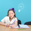 Foto Stock: Smiling girl doing her school work