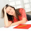 Portrait of beautiful tired business woman sleeping at her workp — Stockfoto