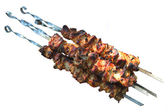 Grilled kebabs on skewers. — Stock Photo
