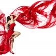 Beautiful womdancing in red dress flying on wind flow over — Stock Photo #10997116