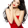 Beautiful woman portrait with red lips, long curly hairs in red — Stock Photo