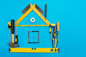 Tools in the shape of house over blue background. Home improveme — Stock Photo