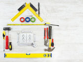 Tools in the shape of house over wooden background. Home improving, repair concept. — Foto Stock
