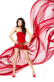 Beautiful woman standing in red flying dress. Hands on hips. Chi — Stock Photo