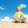 Happy Child Positive Think, Boy Sitting in Yoga Lotus position over blue sky on the top. Kid Happiness and freedom concept. — Stock Photo #11470264