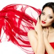 Stock Photo: Beautiful woman portrait in red waving scarf