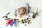 Child drawing picture with crayon in album using a lot of paint — Stock Photo