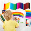 Royalty-Free Stock Photo: Child painting picture with brush in album using a lot of painti