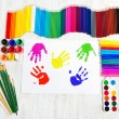 Painting tools set and multicolor child hand prints. Creativity — Stock Photo