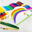 Painting tools set and child drawing picture of rainbow. Creativ — Stock Photo