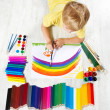 Child painting picture with brush in album using a lot of painti — Stock Photo
