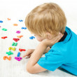 Stock Photo: Child solve the mathematics example. Looking for answer.