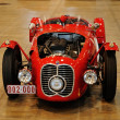 Постер, плакат: Red Maserati A6 GCS and other veteran classic and historic cars