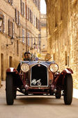 Scalise and Claramunt at the 2012 edition of 1000 Miglia vintage car race they will win — Stock Photo