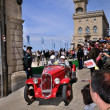 Постер, плакат: Red 1934 Fiat 508 Balilla in San Marino