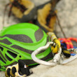 Detail of climbing helmet, carabiner and shoes, focus on carabiner — Stock Photo
