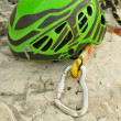 Climbing helmet and carabiner — Stock Photo