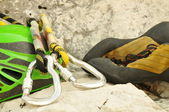 Detail of climbing helmet, carabiner and shoes — Stock Photo
