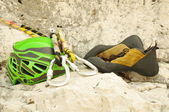 Climbing helmet, carabiner and shoes — Stock Photo