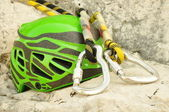 Climbing helmet and carabiners — Stock Photo