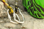 Detail of carabiners with climbing helmet — Stock Photo