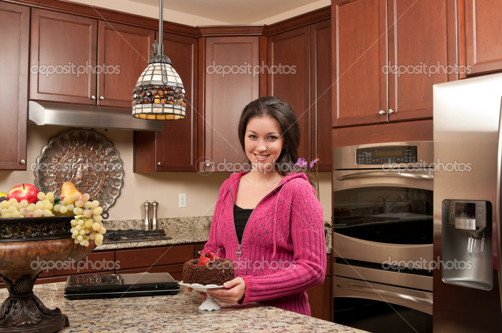 Young woman baking in the kitchen — Stock Photo #11066601