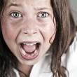 Child Screaming at Camera - Foto Stock