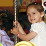 Child in carousel — Stock Photo