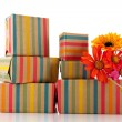 Colorful wrapped presents and flowers — Stock Photo #10817784